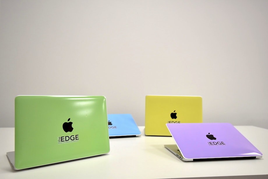 Picture of the four skins applied to their MacBooks and displayed on a table.