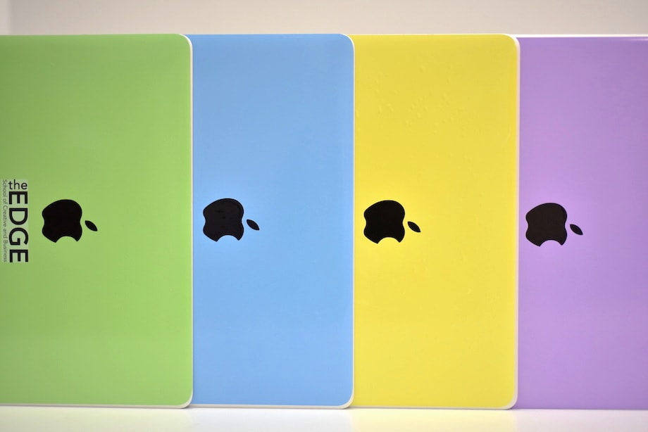 Picture of the four skins applied to their MacBooks and displayed vertically.